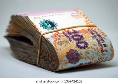 10000 Argentine Pesos with Maria Eva Duarte de Perón (Evita) portrait in 100 Pesos bills that tight with rubber band