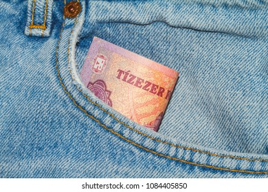 10000 forint banknote in a pocket of a bright jeans. Hungarian currency