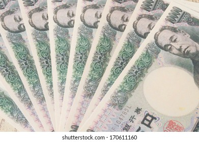 10000 Japanese Yen and 100 dollar BankNote on white isolated.