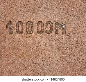 10000 meter measurement mark on a rubberized jogging track.
