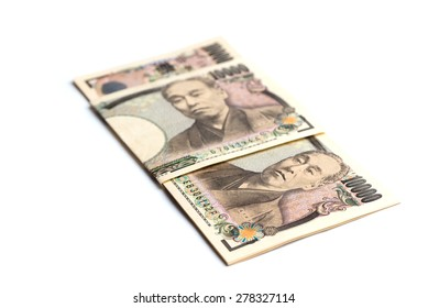 10,000 yen bills wrapped in a folded 10,000 yen bill isolated on white.