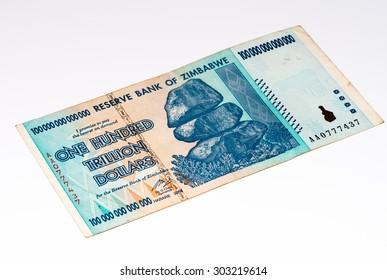100000000000000 (One hundren trillion) Zimbabwe dollars bank note. One of manny currences in Zimbabwe