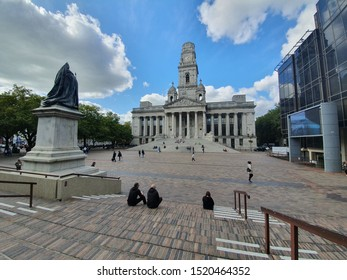 10/02/2019 Portsmouth, Hampshire, UK Portsmouth Guildhall with statue of queen victoria in the foreground and people sat on the steps during their lunch break