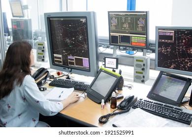 10-02-2021 KAZAN, RUSSIA, Kazan International Airport: woman sits in the airport control room