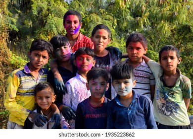 10-03-2020, Dawes, Madhya Pradesh, India,Rural children are playing in colors in happy posture, Concept for Indian festival Holi
