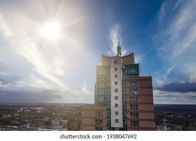 10-03-2020 RIga, Latvia A tall building made of glass. Blue sky and bright sun.