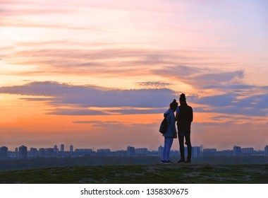 10.04.2018. lovely couple watching selfie photo with background of warm colorful sunset on the hill of old Kalemegdan fortress near river Danube in Belgrade, Serbia