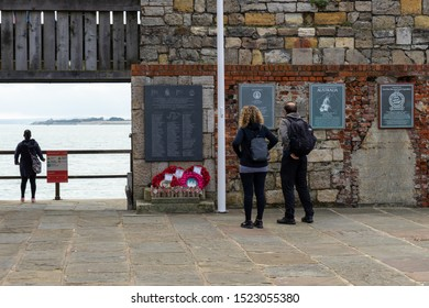 10/05/2019 Portsmouth, Hampshire, UK A couple looking at the Falklands war memorial at hotwalls in old portsmouth