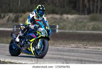 10-05-2020 Ropazi, Latvia Motorcyclist at sport bike rides by empty asphalt road. sport bike. MotoGP race. Superbikes. Motorbikes racing
