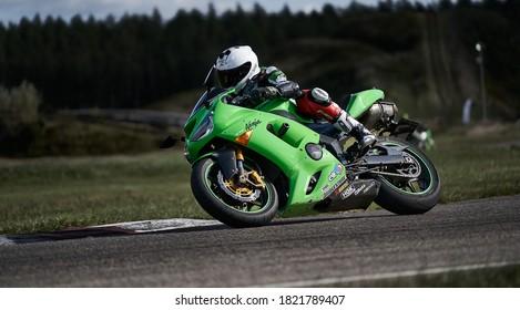10-05-2020 Ropazi, Latvia Motorcyclist at sport bike rides by empty asphalt road. sport bike. Motorcycle at track