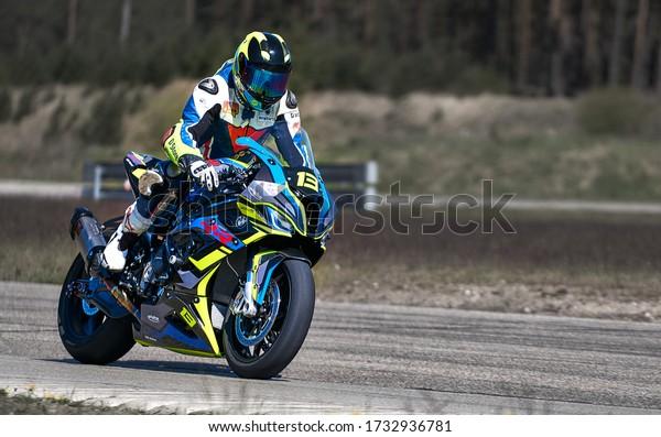 10-05-2020 Ropazi, Latvia Motorcyclist at sport bike rides by empty asphalt road. sport bike.