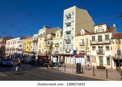 10/09/18 LISBON, PORTUGAL - SEPTEMBER 10th, 2018 : Life is going on on lively streets of Portuguese capital. Beautiful sunlight of the end of the day on the Lisboa facades.
