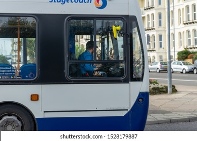 10/09/2019 Portsmouth, Hampshire, UK A bus driver in the cab of a stagecoach bus behind the wheel