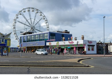 10/09/2019 Portsmouth, Hampshire, UK Clarence pier amusement park in Southsea, Portsmouth with a Ferris wheel or big wheel in the background