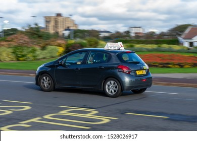 10/09/2019 Portsmouth, Hampshire, UK a driving instructors car moving along the road at speed with the learner driver driving