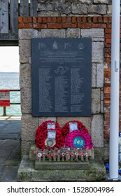10/09/2019 Portsmouth, Hampshire, UK the falkands war memorial st sally port, Old portsmouth, UK with poppy wreaths in front of it