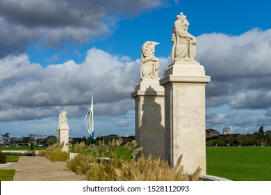 10/09/2019 Portsmouth, Hampshire, UK the lion and unicorn statues at the front of the naval war memorial in Portsmouth UK with spinnaker tower