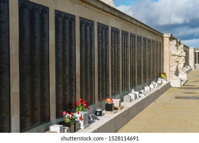 10/09/2019 Portsmouth, Hampshire, UK the names of the dead on the Naval war memorial in Southsea Portsmouth UK with flowers laid in front