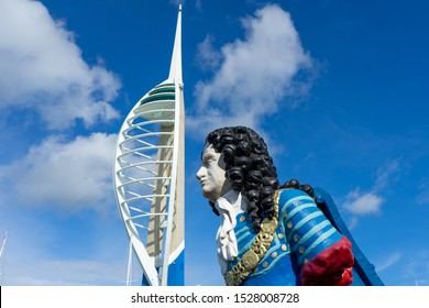 10/09/2019 Portsmouth, Hampshire, UK an old figurehead from a ship with the spinnaker tower in Portsmouth in the background