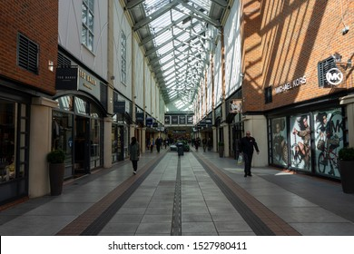 10/09/2019 Portsmouth, Hampshire, UK shoppers walking through the outlet shopping centre at Gunwharf quays Portsmouth UK