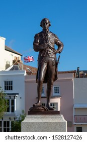 10/09/2019 Portsmouth, Hampshire, UK A statue of Horatio Nelson with a Union jack flag flying in the background, Old Portsmouth UK