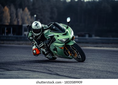 10-09-2020 Ropazi, Latvia Motorcyclist at sport bike rides by empty asphalt road. sport bike.
