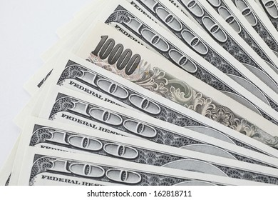 A 100-dollar bill and a ten thousand yen bill
