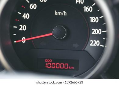 100k mileage on tachometer of car