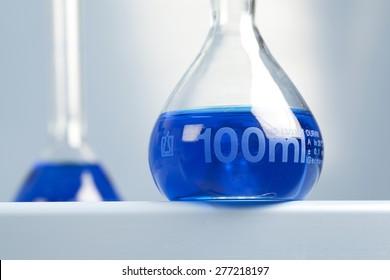 100ml volumetric flask with blue liquid