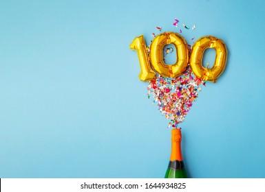 100th anniversary champagne bottle balloon pop