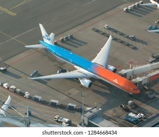 10-10-2018, Amsterdam, Holland. Aerial view of Boeing 777, PH-BVA, at Schiphol Airport from KLM Royal Dutch Airlines. This plane is in blue and orange colours.