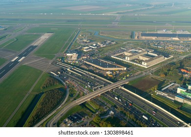 10-10-2018, Amsterdam, Holland. Aerial view of a traffic jam at highway A4 at the Schiphol tunnel. At the right of the runway the fire department and the migrant detention center.