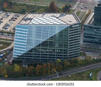 10-10-2018, Amsterdam, Holland. Aerial view of headquarters consultant Deloitte at the business district Zuidas. It is a sustainable glas office building with solar panels on the roof.