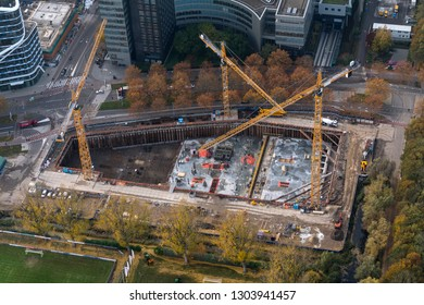 10-10-2018, Amsterdam, Holland. Aerial view of construction site at the business district Zuidas. Foundation has been done. Three big cranes are working.