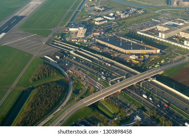10-10-2018, Amsterdam, The Netherlands. Aerial view of a traffic jam at highway A4 at the Schiphol tunnel.  At the right of the runway the fire department and the migrant detention center.