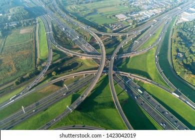 10-10-2018, Den Haag, Holland. Aerial view of a multilevel cloverleaf with underpass, overpass and railway. It is the intersection were highway A4 and motorway A12 connect near The Hague.