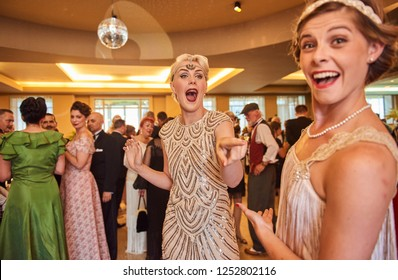 10/10/2018 london, england, Vintage retro Great gatsby girls dancing in formation , throwback retro dancing, nostalgic sexy girls. art deco building.