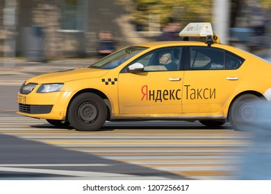 10/19/2018 Russia, Moscow. The city taxi of Taxi Yandex goes down the street in the afternoon through the crosswalk