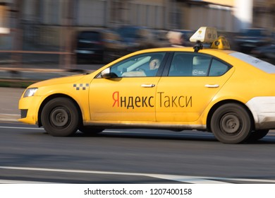 10/19/2018 Russia, Moscow. The city taxi of Taxi Yandex goes down the street in the afternoon