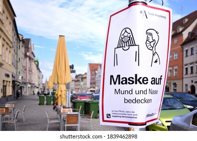 10/22/2020, in Augsburg in Maximilianstraße there is a sign on the side of the road, which indicates that a mask is required for all citizens. Not much going on in the street.