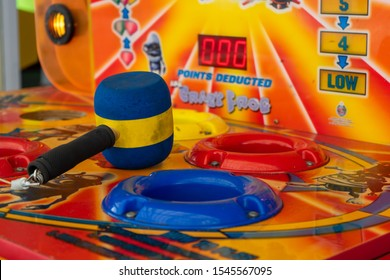 10/30/2019 Portsmouth, Hampshire, UK A whack a mole hammer on a game at the funfair
