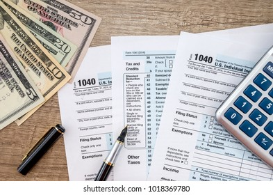1040 Tax form, dollar and calculator