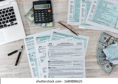 1040 tax form on desk with pen calculator and us dollar. business concept.