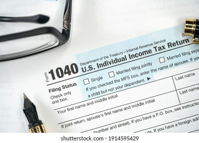 1040 Tax Form. Tax Payment Concept. Filing Taxes Document on Table in Office. Individual Income Tax Return