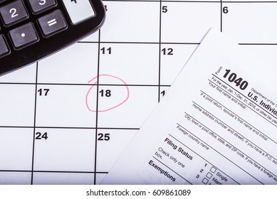1040 tax return with calender and the 18th circled in red