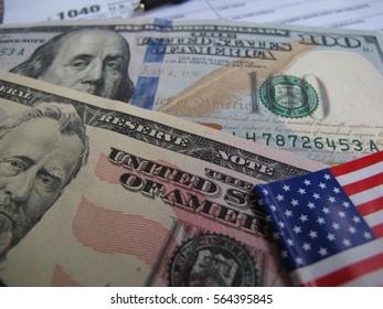 1040 U.S. Individual Income Tax Return and banknote, finance and tax season concept