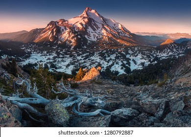 At 10,492 feet high, Mt Jefferson is Oregon's second tallest mountain.Mount Jefferson Wilderness Area, Oregon The snow covered central Oregon Cascade volcano Mount Jefferson rises above a pine forest