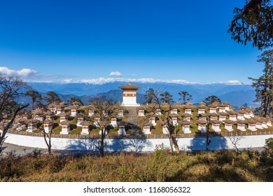 The 108 Chortens of The Druk Wangyal Chortens on Dochula pass between Punakha and Thimpu in Bhutan with the Himalaya at horizon.