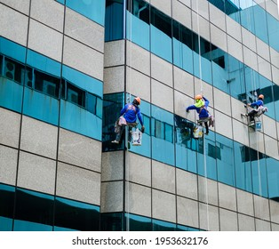 10Apr21, Maleenont tower, Bangkok, Thailand. Spiderman washing Windows in high-rise building. Steeplejacks work on a wall of Maleenont Tower.