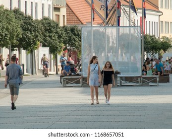 10.august 2018, Trnava, Slovakia, Young girls are talking about walking around the city. One has a head turned towards a girlfriend.